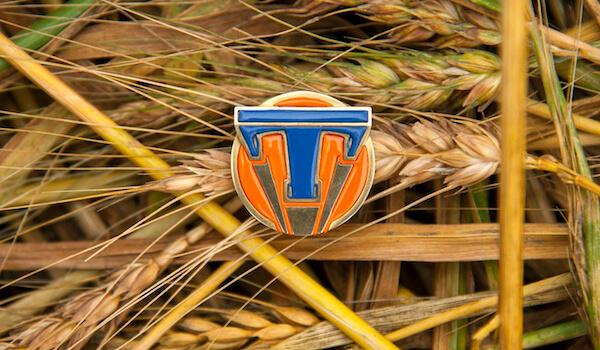 Disney's TOMORROWLAND..Tomorrowland pin ..Ph: Kimberley French..©Disney 2015